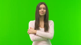 The woman stand on the green screen background