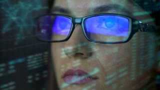 The woman with a glasses look to the virtual display