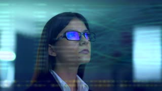 The woman with a glasses over the virtual screen