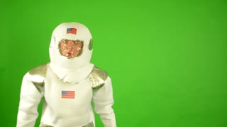 astronaut looks around - green screen