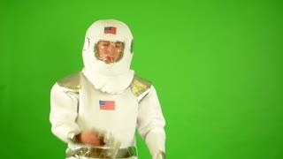astronaut puts on gloves - green screen