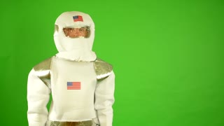 astronaut shows thumbs on agreement - green screen