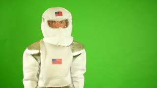 astronaut takes off helmet and smiles - green screen