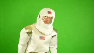 astronaut takes off his helmet and suffocate - green screen