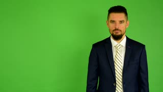 business man agrees (shakes his head) - green screen - studio