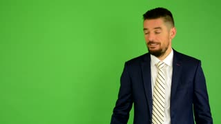 business man introduces - green screen - studio