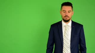 business man phone and smiles - green screen - studio