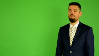 business man speaks (talking) - green screen - studio