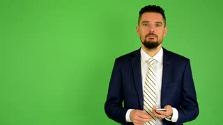 business man works on phone - green screen - studio