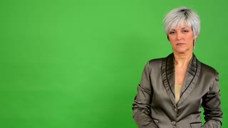 business middle aged woman agrees (shakes his head) - green screen - studio