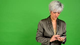 business middle aged woman phone (serious face) - green screen - studio