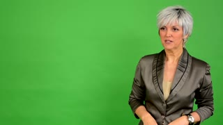 business middle aged woman speaks (talking) - green screen - studio
