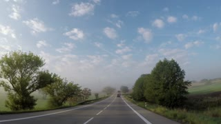 car rides on the road in the countryside - view from car - bad visibility