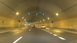 Cars go on road and departure from tunnel