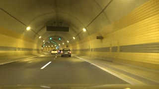 Cars go on road in tunnel in one direction