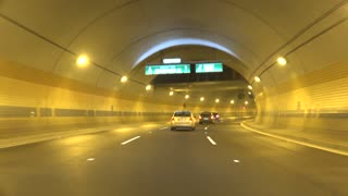 Cars in tunnel go on road according to traffic rules