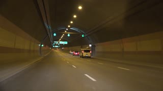 Cars on road in long tunnel