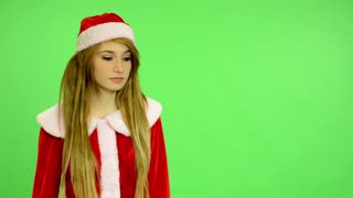 Christmas - Holidays - young attractive - green screen - Woman offers a gift