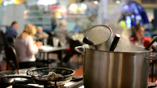 cooking stove with cookware - pots and empty pan - steam - restaurant (people)