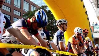 cycling race - cyclist wait - closeup - buildings - start line