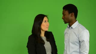 Happy couple talk (conversation) - black man and asian woman - green screen