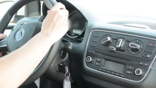 man drives the modern car - detail of holding steering wheel