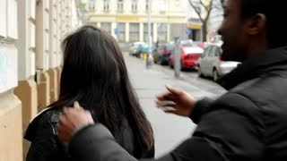 Man surprises woman - young model couple in love - happy couple embrace and talk