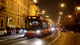 night city - night urban street with cars and trams - timelapse - car headlights