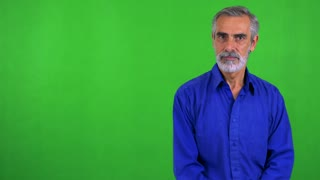 old senior man agrees (shakes with head) - green screen - studio