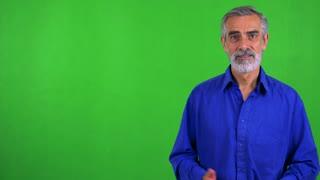 old senior man introduces something - green screen - studio