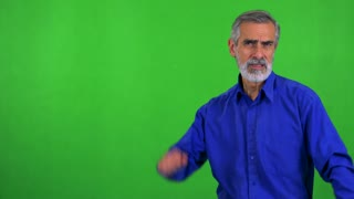 old senior man is angry (protest) - green screen - studio