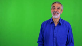 old senior man rejoices - green screen - studio