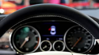PRAGUE, CZECH REPUBLIC, CAR EXHIBITION - SEPTEMBER 27, 2014: speedometer and detail of logo (wheel) - Bentley (interior)