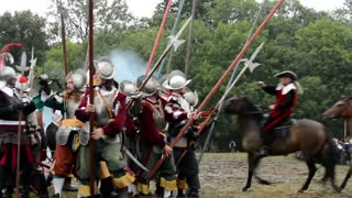 PRAGUE, CZECH REPUBLIC, SHOW: BATTLE OF WHITE MOUNTAIN - SEPTEMBER 20, 2014: warriors riding a horses - soldiers fight each other- military - battleground (army forces) - battlefield