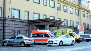 safety and rescue service (police and ambulance service) - parked cars- building