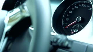 Slowmotion view on speedometer of dashboard in car