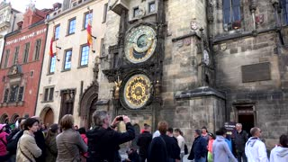 The Old Town Hall - Prague astronomical clock - walking people - travelers look