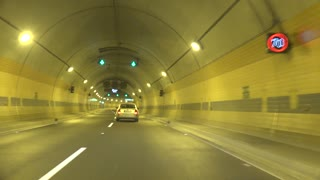 Timelapse cars go in tunnel in lane