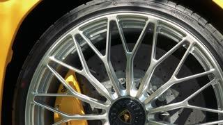 Aluminium wheel and brake disc of Lamborghini Aventador modern car - closeup