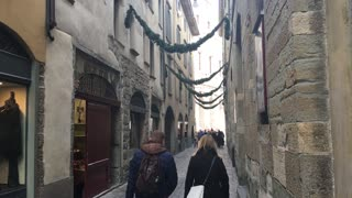 City Bergamo in Italy people walk in urban bystreet