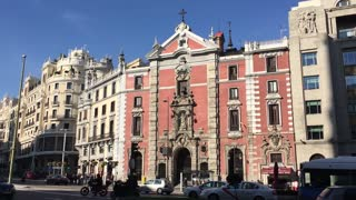 City Madrid in Spain busy urban street in front of historical building