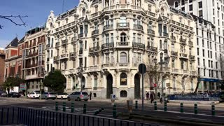 City Madrid in Spain old beautiful historical building next to road