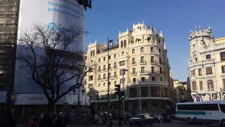 City Madrid in Spain traffic on road in historical downtown