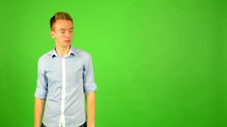man - green screen - portrait - man agrees (shows thumbs up for approval)