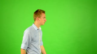 man walks around - green screen - (man waits)
