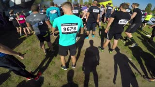 POV - a man and other participants run from the start at a race