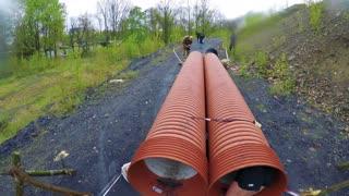 POV GoPro - a man crawls through a pipe at a race