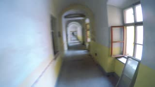 POV GoPro - a man runs down a corridor of an old building at a race