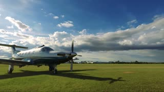 Private airplane in a small field airport - sunny sky