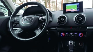 The dashboard and the GPS of a luxurious car - closeup